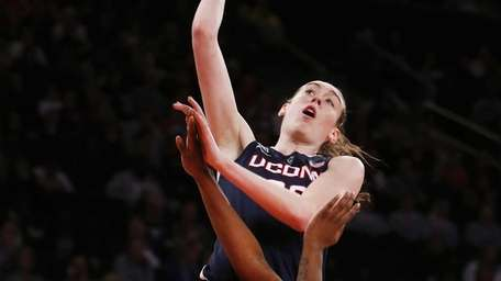 Connecticut's Breanna Stewart, top, goes to the basket