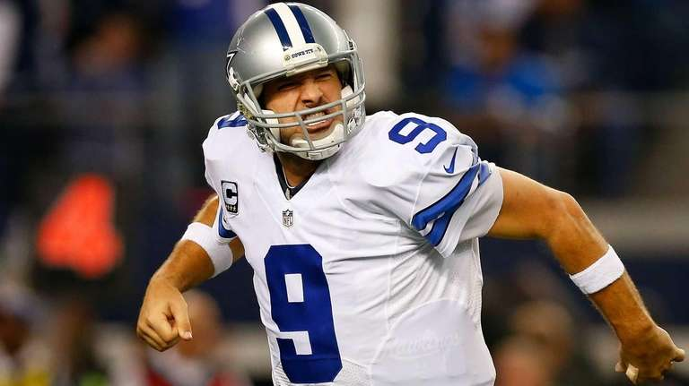 Tony Romo #9 of the Dallas Cowboys reacts