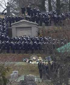 NYPD officers salute as Wenjian Liu is buried
