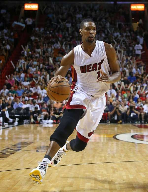 Chris Bosh of the Miami Heat drives to