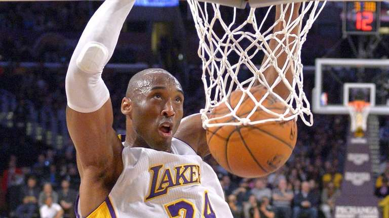 Los Angeles Lakers guard Kobe Bryant dunks during