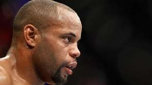 Daniel Cormier waits in a time-out as he