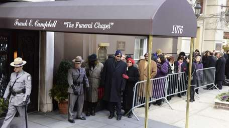 Mourners arrive at the Frank E. Campbell Funeral