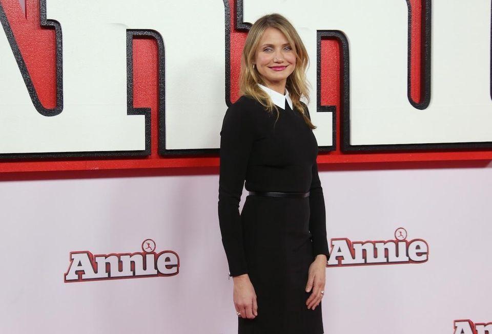 Actress Cameron Diaz poses for photographs during a