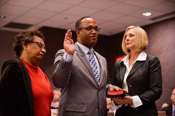 Presiding Officer Duwayne Gregory is sworn in as