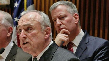 New York Mayor Bill de Blasio, right, listens