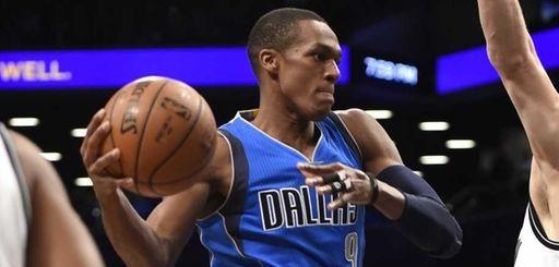 Dallas Mavericks guard Rajon Rondo tries to pass