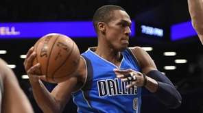 Dallas Mavericks guard Rajon Rondo tries to pass