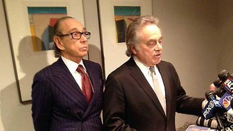 Sanford Rubenstein left, stands behind his lawyer Ben