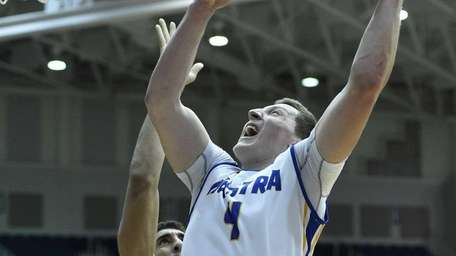 Hofstra forward Rokas Gustys attempts a layup against