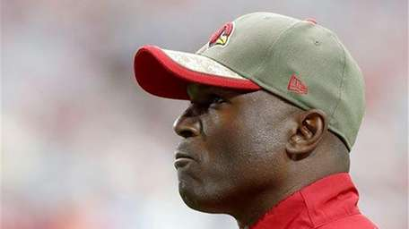 Arizona Cardinals defensive coordinator Todd Bowles watches his