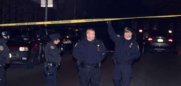 Two NYPD officers responding to a robbery in