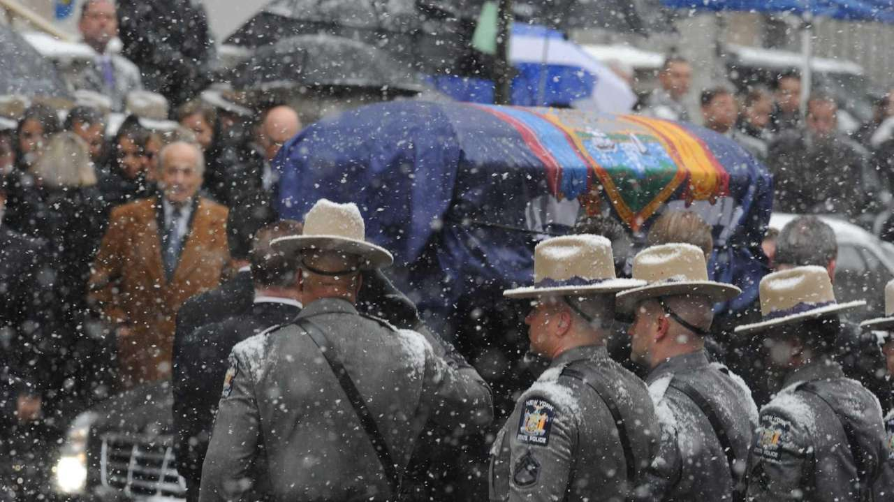 New York State troopers escort the hearse carrying