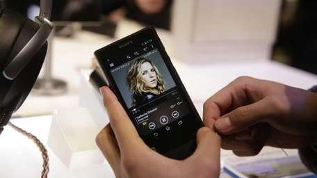 An attendee holds Sony's new Walkman at the