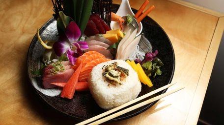 Chirashi, assorted sashimi with seasoned rice, is a