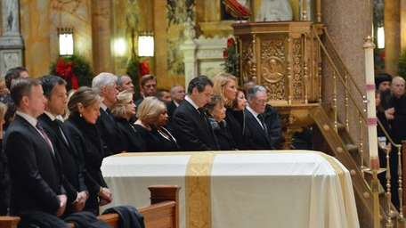 Many gather during the funeral of Governor Mario