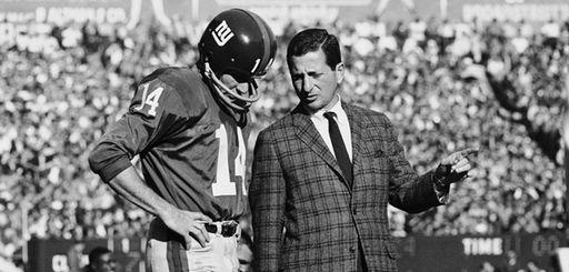 Giants quarterback Y.A. Tittle listens as coach Allie