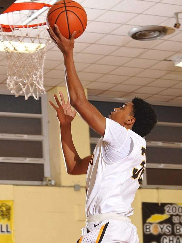 Uniondale's Kyle Harding drives to the hoop during