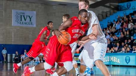 Stony Brook forward Jameel Warney is defended by