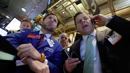 Specialist Michael Pistillo, left, and trader Edward Schreier