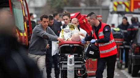 An injured person is transported to an ambulance