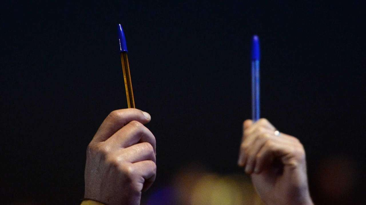 People hold pens in Marseille, southern France, on