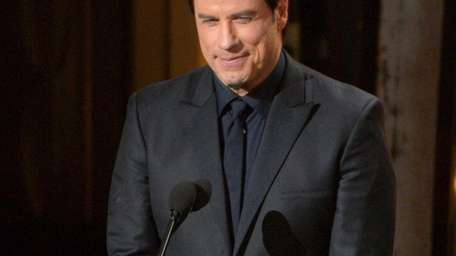 John Travolta speaks during the Oscars on Sunday,