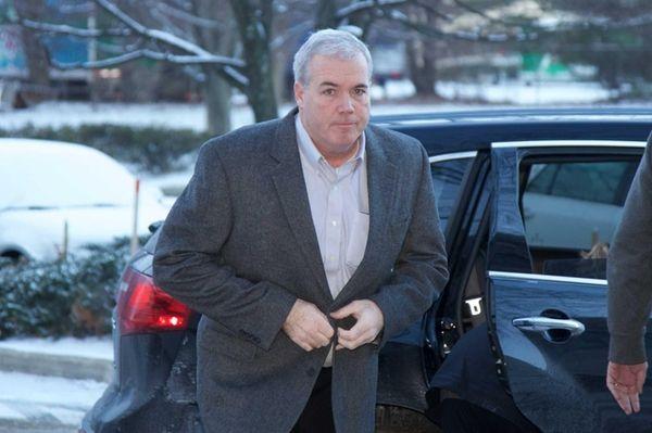 Edward Walsh enters the FBI field office in