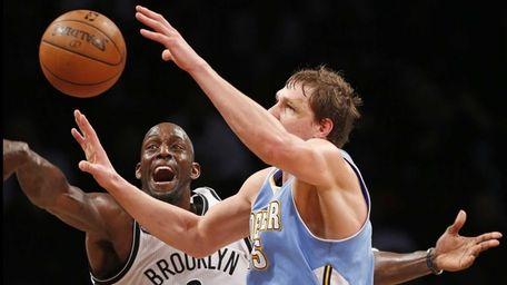 Brooklyn Nets forward Kevin Garnett (2) knocks the