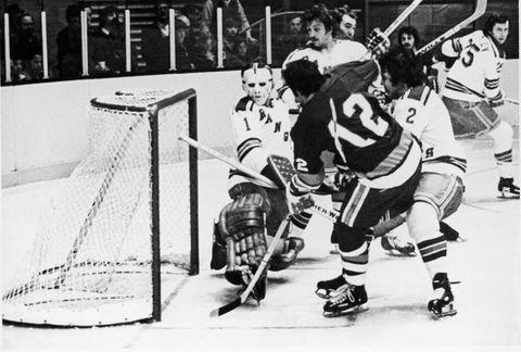 J.P. Parise of the Islanders scores a goal