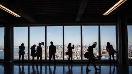 Visitors tour office space on the 63rd floor