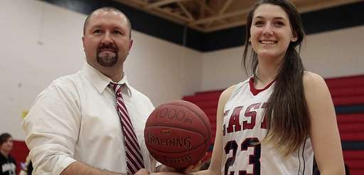 Smithtown East's Samantha Delaney receives a game ball