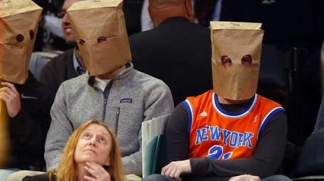 Fans of the New York Knicks watch a