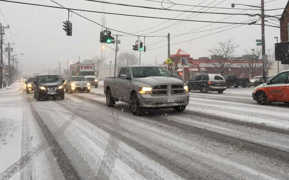 Snow falls during the commute on Jericho Turnpike