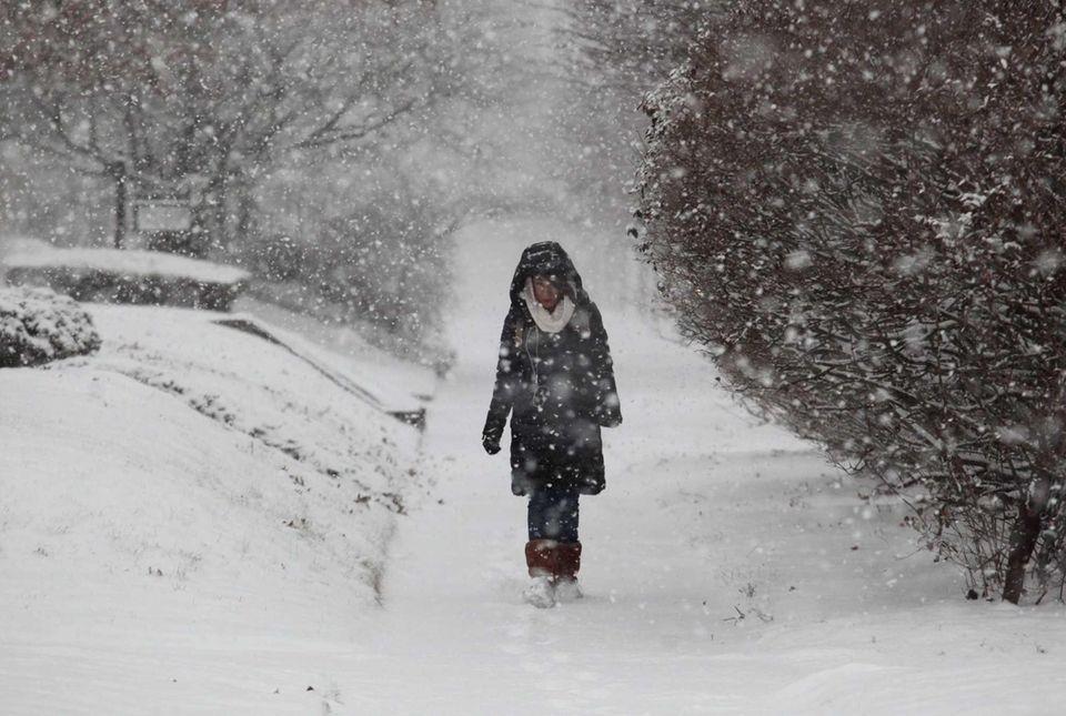 Hatch Mumcu walks through the snow on Mineola