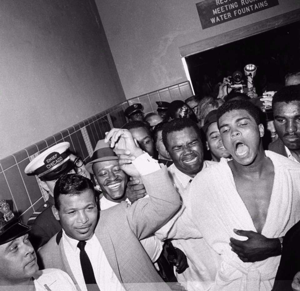 FILE -- Sugar Ray Robinson, left, and Cassius