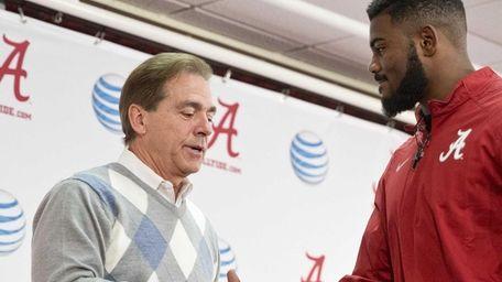 Alabama head coach Nick Saban shakes Landon Collins