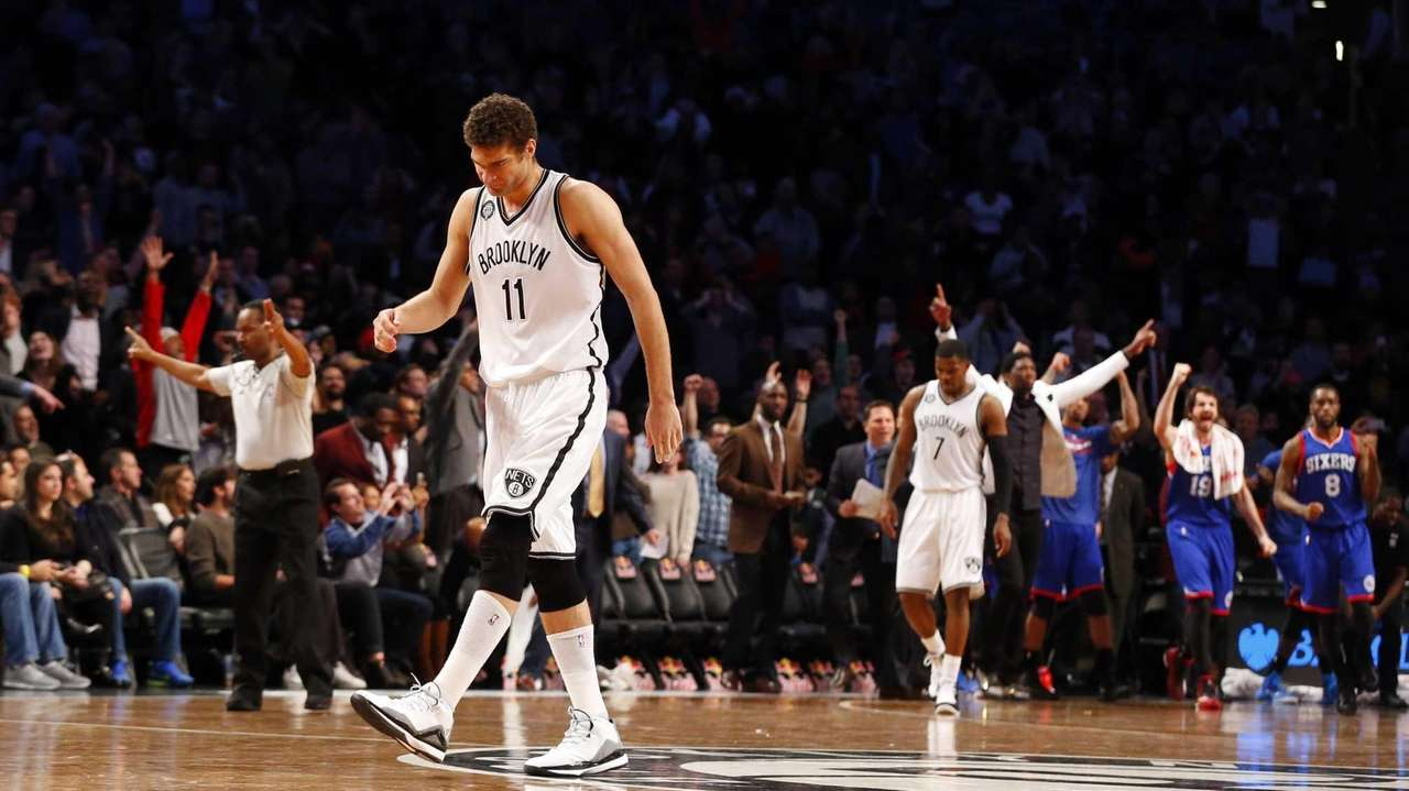 Brook Lopez of the Brooklyn Nets walks off