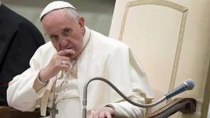Pope Francis listens to a speech during a