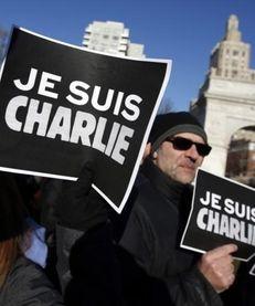 "Attendees hold ""Je Suis Charlie"" (I am Charlie)"