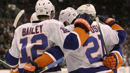New York Islanders' players celebrate their goal against