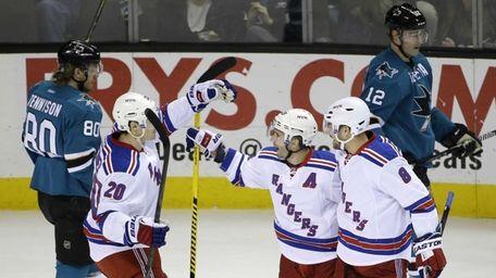 New York Rangers' Martin St. Louis, center, celebrates