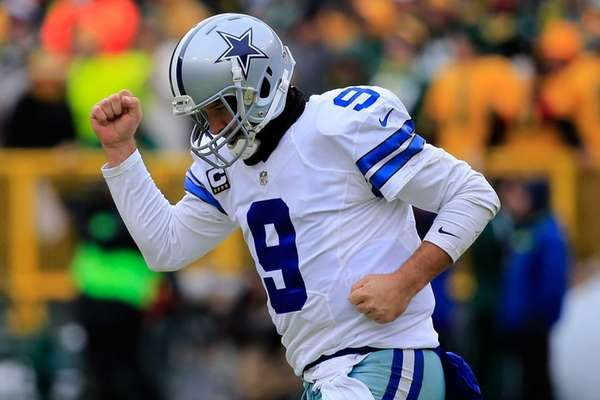 Quarterback Tony Romo of the Dallas Cowboys reacts