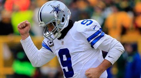 Quarterback Tony Romo of the Dallas Cowboys reacts