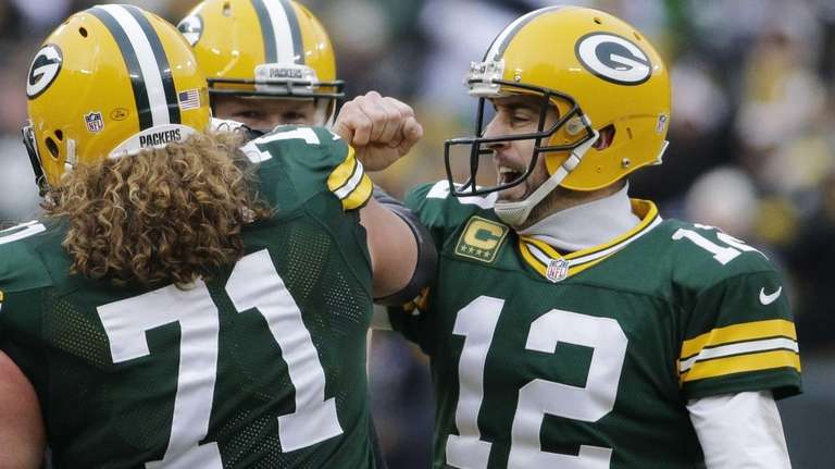 Green Bay Packers quarterback Aaron Rodgers (12) with