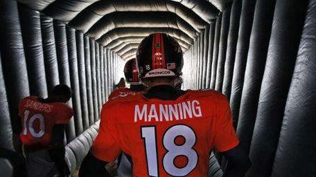 Denver Broncos quarterback Peyton Manning (18) prepares to