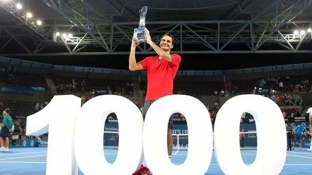 Roger Federer of Switzerland holds the Roy Emerson