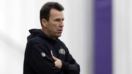 Baltimore Ravens offensive coordinator Gary Kubiak walks on