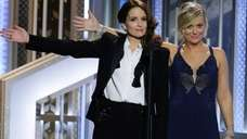 Co-hosts Tiny Fey, left, and Amy Poehler introduce