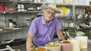 Earl Fultz stands with the spices that go